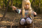 Creative little girl playing with wooden twigs — Stock Photo