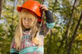 Cute little girl adjusting her hardhat — Stock Photo