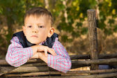 Thoughtful serious young boy — Stock Photo