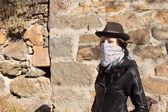 Stylish young female bandit — Stock Photo