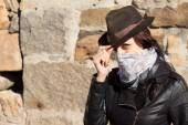 Young woman bandit doffing her hat — Stock Photo
