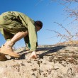 Young Male Scout Climbing a Rock at the Field — Stock Photo #57550693