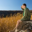 Young Boy Scout on Rock Watching Wide Field — Stock Photo #57550823