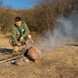 Male Scout Grilling Sausages in Old Way — Stock Photo #57550915