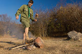 Park ranger stamping out a cooking fire — Stock Photo