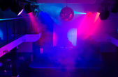 DJ in Night Club Lit with Colorful Lights — Zdjęcie stockowe
