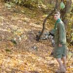 Scout or ranger walking through woodland — Stock Photo #57659763