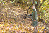 Scout or ranger walking through woodland — Stok fotoğraf