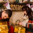 Young couple opening festive gold Xmas gifts — Stock Photo #58734011