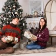 Happy Friends Holding Gifts near Christmas Tree — Stock Photo #58732931