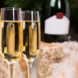 Glasses of Champagne on Elegant Flute Glasses — Stock Photo #58733559