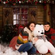 Young Couple Hugging White Winter Bear Doll — Stock Photo #58734347