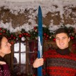 Couple with Skis Standing in front of Log Cabin — Stock Photo #58738283