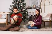 Happy young couple celebrating Christmas — Foto de Stock