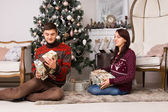 Happy young couple celebrating Christmas — Стоковое фото