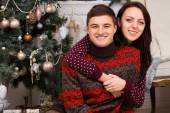 Happy loving couple celebrating Christmas — Стоковое фото