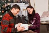 Smiling Couple with Presents Near Christmas Tree — Стоковое фото