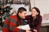 Happy Couple Laughing Near the Christmas Tree — Стоковое фото