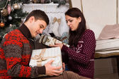 Sitting Young Partners Holding Christmas Presents — Стоковое фото