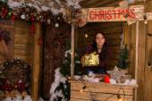 Woman Holding Gift Box at Mini Christmas Booth — Стоковое фото