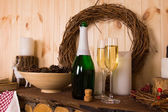 Flutes and bottle of champagne — Stock Photo