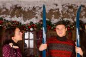 Couple with Skis Standing in front of Log Cabin — Stock Photo