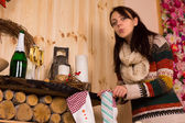 Woman Sneaking a Peek inside Christmas Stocking — Stock Photo