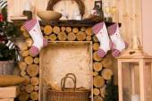 Christmas Stockings Hanging from Rustic Mantle — Стоковое фото