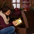Sitting Woman Getting Golden Presents from Trunk — Stock Photo #58968037