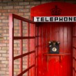 Old Fashioned Red Telephone Booth with Open Door — Stock Photo #61428725