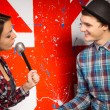 Woman with Microphone Talking To Man — Stock Photo #61428851
