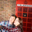 Sweet Couple Taking Selfie at Telephone Booth — Stock Photo #61428885
