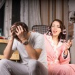 Couple in a run down room sitting arguing — Stock Photo #61428981
