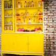Colorful bright yellow welsh dresser — Stock Photo #61429015