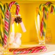 Colorful festive candy canes in glass jars — Stock Photo #61429029