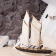 Toy yacht and wrecked wooden ship — Stock Photo #61429041