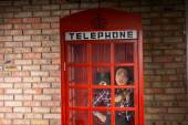Woman Calling Someone in a Closed Telephone Booth — Photo