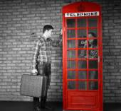 Young Man Knocking at the Telephone Booth — Stock Photo