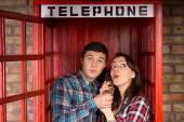 Young couple enjoying a gossip — Stock Photo