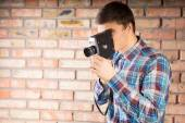 Young Man Picture Using Vintage Camera — Foto Stock