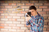 Young Man Capturing Something Using Camera — Foto Stock