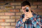 Young Man Capturing Something Using Camera — Stock Photo
