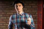 Young Man in Checkered Shirt Holding Smoking Pipe — Stock Photo