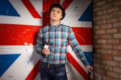 Man in Checkered Shirt and Jeans In Front UK Flag — Stockfoto