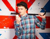 Smoking Young Man with Cane on his Shoulder — Stock Photo