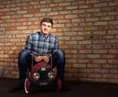 Young Man Playing with Toy Automobile — Stock Photo