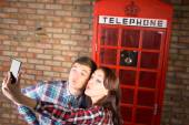 Sweet Couple Taking Selfie at Telephone Booth — Stock Photo