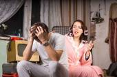 Couple in a run down room sitting arguing — Stock Photo