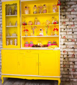 Colorful bright yellow welsh dresser — Stock Photo