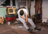 Sleeping Man Sitting on Cage at Junk Room — Stock Photo
